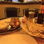 Chicken curry with garlic naan bread and Indian beer
