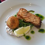 Salmon fillet with Romesco, Langostine croquette on a bed of wild rocket and herb mayonnaise