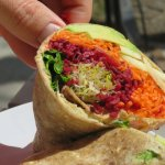 Veggie wrap filled with all kinds of fresh veggies