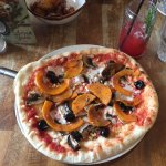 Vegan pizza with added butternut squash, olives, mushrooms & pine nuts