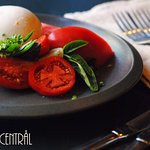 Burrata with five different tomatoes and fresh basil