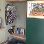 Quiet ,melodic music and a book exchange shelf brighten up this corner