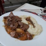 Pork with apricots and mashed potatoes