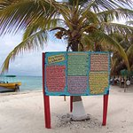 Sign with some info about threats to Laughing Bird Caye NP