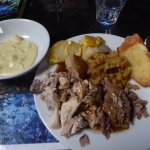 Hot buffet meal, 2 kinds of potato, chicken, lamb, dressing and pudding