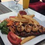 My Husband's Food (steak, shrimp, salad, fries) & South Beach Iced Tea