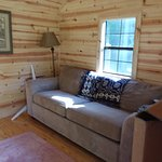 Inside glamping cabin, pull-out Queen couch