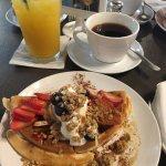 Sweet breakfast waffle, tea, and juice