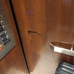 Elevator with busted side paneling