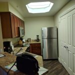 Full kitchen with a washer & dryer behind those double doors!
