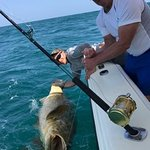 Goliath Grouper and 2 worn out fisherman