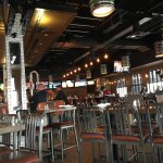 The inside has lots of tv's, wooden tables, metal chairs and beer kegs for lighting. A manly typ