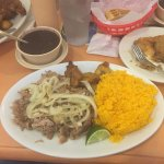 Roasted pork with black beans, rice, and fried plantains