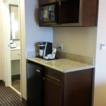 Microwave, refrigerator, and Keurig coffee maker.