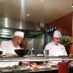 The chef on the left is making the sushi bowl.s