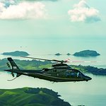 Agusta 109s Grand flying over land and sea