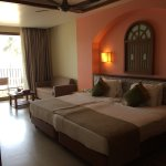 Our spacious room with a comfy bed and a nice sofa to relax on.