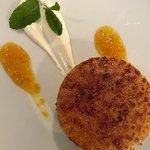 Caramelized lemon tart, orange sauce and sour cream