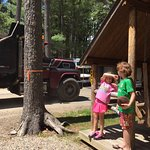 My daughter protecting herselves of the dust generated by trucks passing our cabin