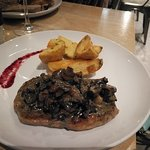 The 250g Aged ribeye steak with creamy herbed wild mushroom sauce
