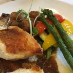 Stuffed coq au vin with roasted potatoes and fresh roasted veggies
