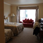VERY large room with two beds and sofa! Nice view overlooking the gardens and dining area.