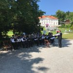 Band playing in front of the house
