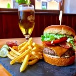 The orginal Mangrt Bacon Cheesburger with pommes frites & homemade pickles! Enjoy with a cold be