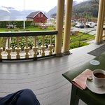 Enjoying a cup of coffee and my book from the front porch, overlooking the fjord.