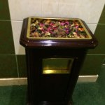 Mahogany rubbish bin with potpourri in the top. The whole place smells wonderful!