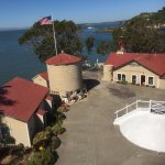 View from the top. In back is original foghorn and machinery building. White dome is cistern.