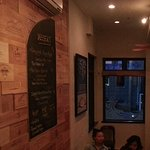 Nicely decorated interior - love the wine boxes wall covering