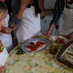 Preparing the fresh bruschetta.