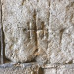 the mark on the right of the main door showing the consecration of the abbey - made in 1121!!