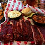 Half slab of ribs, potato salad, baked beans, corn muffin.