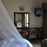 Desk in room. Mosquito net on bed. (Few mosquitos though.O