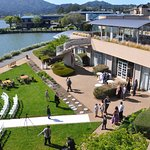 Wedding being held on grounds with Richardson Bay at high tide