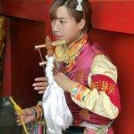Tribal girl playing music