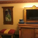 Royal Room - TV, Tiama Framed Photo, stool, dresser with Refrigerator in it and about 3 drawers