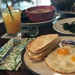 Egg and toast with spinach, porridge, and orange juice