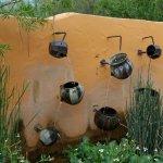 A beautiful wall fountain, using clay pots.