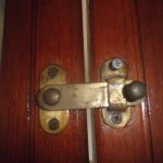 Latch which was lifted by me to gain access to room showing new screw to prevent latch being lif