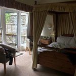 Lovely room with a four poster bed