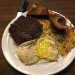 Buffalo Hamburger steak, eggs over easy, hashbrowns, and toast