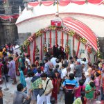 Devotees throng the temple throughout the day.