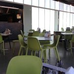 The cafe seating arrangements close to the kitchen and exit doors