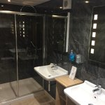 Bath room with his and her basins plus double rain shower
