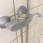 shower installation, very old and full of limescale