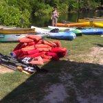 Kings Landings canoes pulled on shore.