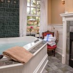 The large jacuzzi tub is the spotlight in the Carriage House bathroom.